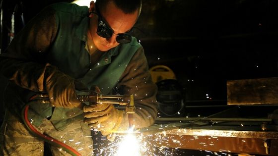Welder working metal traps