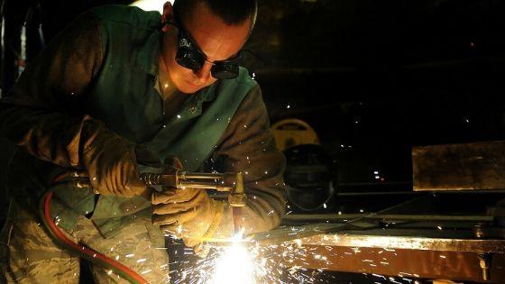 Welder working metal traps