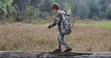 Kid Hiking on Log with Backpack